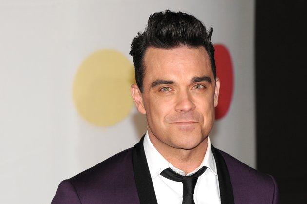 Robbie Williams dice que compraría drogas de calidad a su hija
