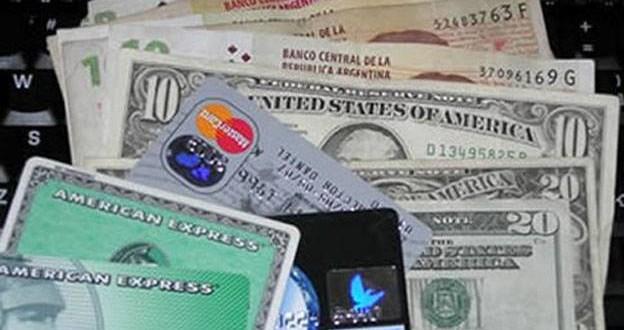 Cómo pagar saldos en dólares de tarjetas de credito