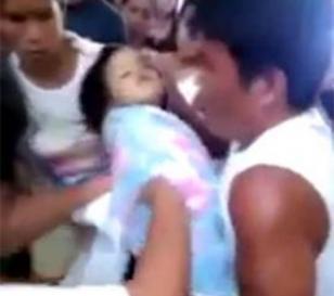 Niña filipina resucita en su propio entierro