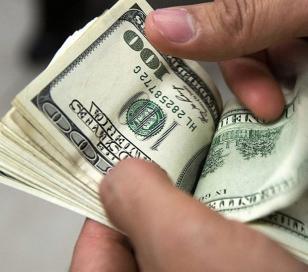 Dólar ilegal baja a $14.60